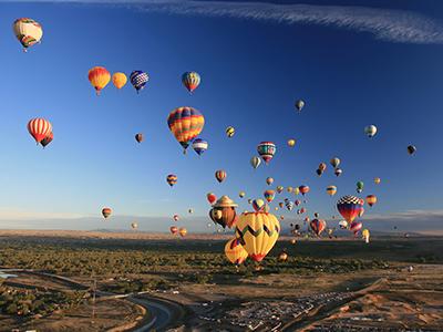 Hot air balloons fill the sky at the balloon fiesta